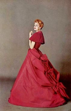 Fairy tale loveliness in yards of rich, gorgeous amaranth. #1950s #fashion I love this, it's beautiful.