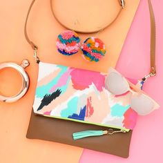 Getting my accessories ready for the @createandcultivate SXSW pop up on Sunday! Who else is going to be there? Let's meet up!  BTW you can snag this new abstract Crossbody bag and your own Pom Pom earrings in my etsy shop! Kailochic.etsy.com
