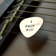 'I pick you' guitar pick - corny but cute for your grooms wedding gift (if he plays the guitar, of course).