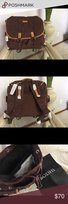 "BODHI LAPTOP BACKPACK Brown canvas/leather laptop backpack.  Measures approx 15"" tall X 14 "" long X 6 1/2 wide.  Chocolate brown/saddle.  Comes with a dust bag.  Retail value $278.00.  This bag would work for a man or woman.  Great gift idea! BODHI Accessories Laptop Cases"