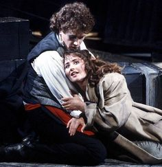 Michael Ball ( Mauris) and France's Ruffelle ( Eponine). During  a little fall of rain at the Barbican Theatre 1985.