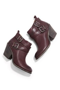 Wine-colored leather booties with buckled straps