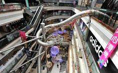 """Next time you're in Shanghai, skip the skyscraper selfie and head straight to the mall. The Printemps Department Store in the Pudong district just opened its five-story, 177-foot long """"Happy Slide"""" and it looks both incredible and slightly terrifying."""