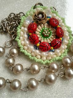 """and they all played games at the ladybugs picnic""     ladybug pendent on pearl and chain necklace  Create Beautiful Beads  $32"
