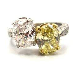 """Platinum, 18 karat yellow gold, yellow & white diamond """"crossover"""" ring featuring a 1.59 Carat Oval Brilliant Cut Natural Fancy Intense Yellow diamond & a 1.51 Carat Oval Brilliant Cut White diamond with smaller white round cut diamond accent stonesPrice Upon Request"""