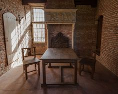 The first Rietveld chairs designed and constructed in 1905 at the Gate Tower of Zuylen Castle, Nederlands. The table couldn't be removed since then.