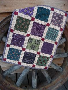 Scrappy Doll Quilt - sashing and blocks make the squares pop