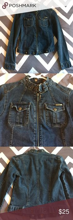 DKNY Denim Jacket DKNY denim jacket size Small. Materials: cotton 98% spandex 2%. Features dark blue denim with bronze colored hardware. Has full length zip front closure, buckle at neck, two breast pockets. Has some stretch to it. Completely intact, no flaws. Gently used. DKNY Jackets & Coats Jean Jackets