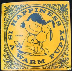 Happiness is a Warm Puppy - my favorite Peanuts book
