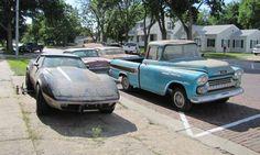 Vintage Chevrolet truck alongside Corvette