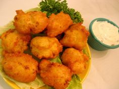Crispy cheese-filled fritters with mild cauliflower and onion flavors. Easy to make and to-die-for delicious! My 3 year old loves to dip em in ketchup.