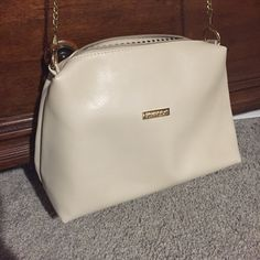 Michael Kors purse! Very pale pink purse with gold chain strap. Interior is black and white strips. No stains or marks! Michael Kors Bags Cosmetic Bags & Cases