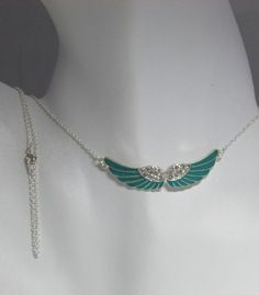This is a selection of angel wing necklaces Asst. Colors