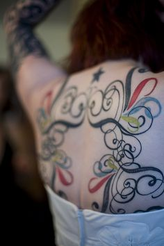 back tattoo-like all the use of color & upper middle looks like eyes with mustache..