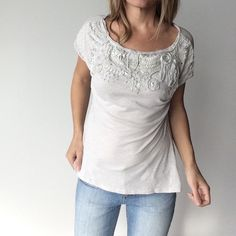 SALEC.Keer (Anthro) light gray embellished top Anthropologie light gray detailed embellished top Pre-owned- great condition, no holes or stains. Made of 100% cotton. Details are silver tone. Size Medium. Measurements:  Underarm to underarm flat across is approximately 19 inches. Back of neck to bottom of hem is approximately 21 inches. C. Keer Tops