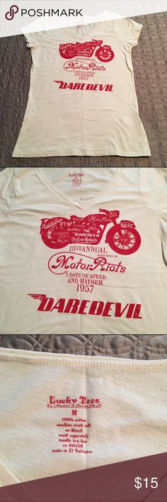 Lucky Brand Motor Riots Daredevil Tee Awesome Lucky Brand v-neck tee with a bold red motorcycle graphic. Pair with your favorite jeans and Moto jacket! Worn once, excellent condition. ❌No trades Lucky Brand Tops Tees - Short Sleeve