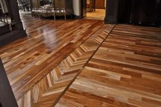 Chevron borders between rooms helps to merge and blend old and new hardwood floors.