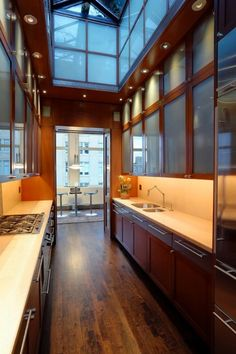 Gorgeous galley kitchen with amazing ceiling details