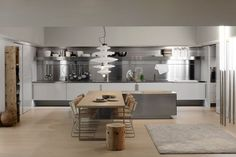 Contemporary stainless steel kitchen SPATIA: COMPOSITION 1  Arclinea