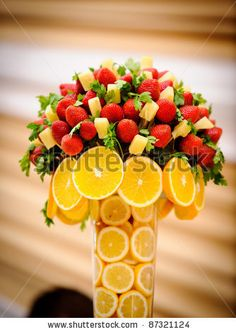 maybe with flowers coming out of the top and lemons concealing the stems!