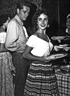 Elizabeth Taylor and her first husband, Nicky Hilton, at a Western barbeque