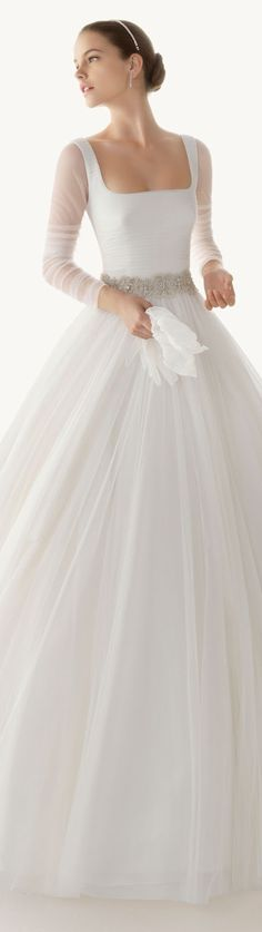 Long-sleeved, full-skirted with clean lines for a wedding dress.  Nice tank top/long sleeve and a Tulle skirt = potentially beautiful imitation of this gorgeous dress