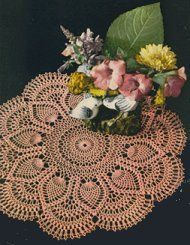 """Doily - """"Pink Pineapple"""" - 1951. Normally, not a huge pineapple fan, but the sharp outlines of the individual motifs elevate this design."""