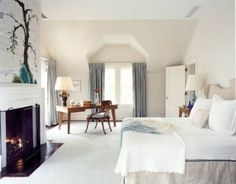 Bursts of blue make an impact in this neutral bedroom designed by David Kleinberg.