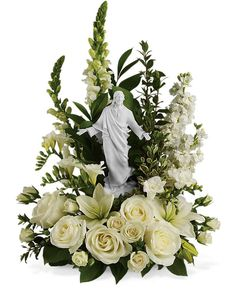 This serene, all white funeral bouquet features a porcelain likeness of Jesus designed by famed artist Stuart Mark Feldman. A sacred choice to send to the church or funeral home, the religious arrangement evokes divine grace and Christian purity. Arrangements Funéraires, Funeral Floral Arrangements, Funeral Bouquet, Funeral Flowers, Casket Flowers, Bouquet Flowers, Cascading Bridal Bouquets, Memorial Flowers, Cemetery Flowers