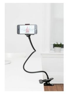 A gooseneck phone holder that securely clips to a desk or table.