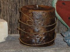 Grungy Candle...take rusty wire and wrap around a grunged candle for a primitive look.