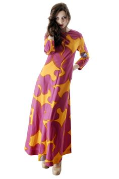 Stunning 100% cotton floor length Marimekko dress has long sleeves and a center back zipper closure. The bold, mod pattern is executed in fuchsia,gold, and periwinkle. Four rows of stitching are intac