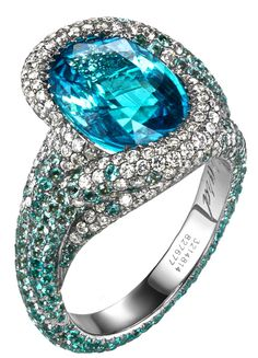 Blue Paraiba tourmalines by Chopard... love this stone! LetsBuyJewelry.com