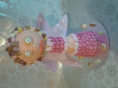 Delicious fairy with dolly mixtures hair and rice paper wings