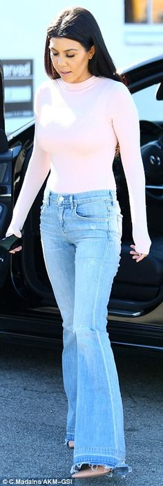 She has great jeans! The 36-year-old worked a ripped pair of distressed bell bottoms that ...