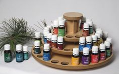 "Lazy susan essential oil holder. Holds 36  15ml bottles and 24  5ml bottles for a total of 60 bottles in a 13"" circle. This sturdy design allows you to find your oils and places them quickly within reach.  Made from maple and composite wood.   Each of the 60 holes has a black felt bottom. drusselldesigns.com"
