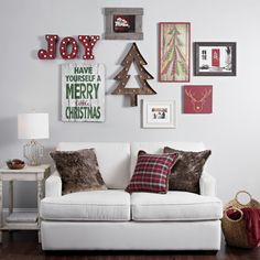 Deck your walls for Christmas by adding Christmas art to your gallery wall. Switch out a few old photos with images of Santa, joyful quotes or nostalgic landscapes and you will have a festive holiday gallery wall! Read more tips on our blog.