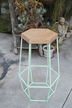 Timber & Ore Stool  We love the open-frame hexagonal shape of the Timber & Ore barstool from Los Angeles brand-building firm WoodSmithe. Made from tie wire, canvas, and plywood, pallet or salvaged wood, the stools possess a spare architectural quality. The open-air construction lets them occupy very little visual space, but the shapely frame feels fresh and modish in pop-art pastels.  via ignant.de
