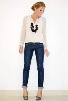 Dark jeans, cream blouse, back statement necklace