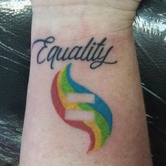 lesbian tattoo, LGBTQ rainbow equality tattoo on wrist