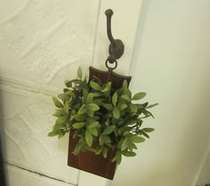 Down to Earth Style: an old iron hook holds a match box and greenery