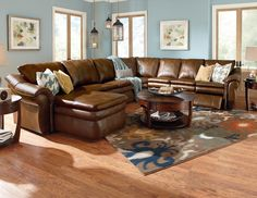This sleek contemporary leather sectional sofa is a perfect example of modern…