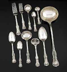 Devonshire pattern - A Victorian silver flatware service, George w. Adams (Chawner & Co.), London, 1854, comprising eighteen table spoons, eighteen dessert spoons, seventeen tea spoons, six coffee spoons, four condiment spoons, three gravy ladles, five sauce ladles, twenty nine dinner forks, eighteen dessert forks, a large soup ladle and a sifter spoon, all engraved with an armorial cresting, (120), 9050gms (approx)