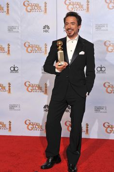 """Robert Downey Jr. being interviewed by the media after winning the Golden Globe Award for Best Actor for """"Sherlock Holmes,"""" 2010."""