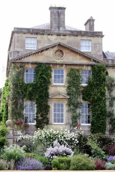 Ivy clinging to an English Manor house with a classic wild-influenced English flower garden. The home is Bowood, built in the Photo by Madelief English Country Gardens, English Manor, English House, English Countryside, Cottages Anglais, Design Exterior, Purple Home, French Country House, Country Houses