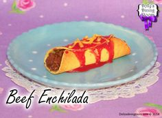 Spice up your life with this spicy beef enchilada! Ground beef fills the inside of a warm corn tortilla then it's topped with Dolly's famous enchilada sauce and cheddar cheese.  What a delicious way to eat dinner!