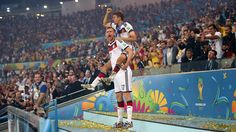 RIO DE JANEIRO, BRAZIL - JULY 13: Per Mertesacker (L) and Thomas Mueller of Germany celebrate on the podium during the award ceremony after the 2014 FIFA World Cup Brazil Final match between Germany and Argentina at Maracana on July 13, 2014 in Rio de Janeiro, Brazil. (Photo by Friedemann Vogel - FIFA/FIFA via Getty Images)
