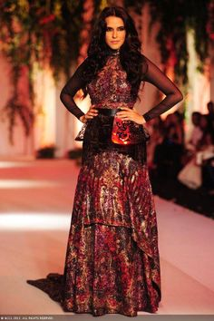 Actress Neha Dhupia displays a creation by designers Falguni and Shane Peacock on Day 3 of India Bridal Fashion Week in New Delhi on July 25, 2013
