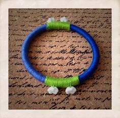 Handcrafted woven thread bangle with flower beads made of stone