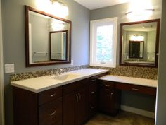 Stained cabinetry with decorative hardware. Cultured marble countertops. Mini mosaic tile backsplash. Tile flooring.